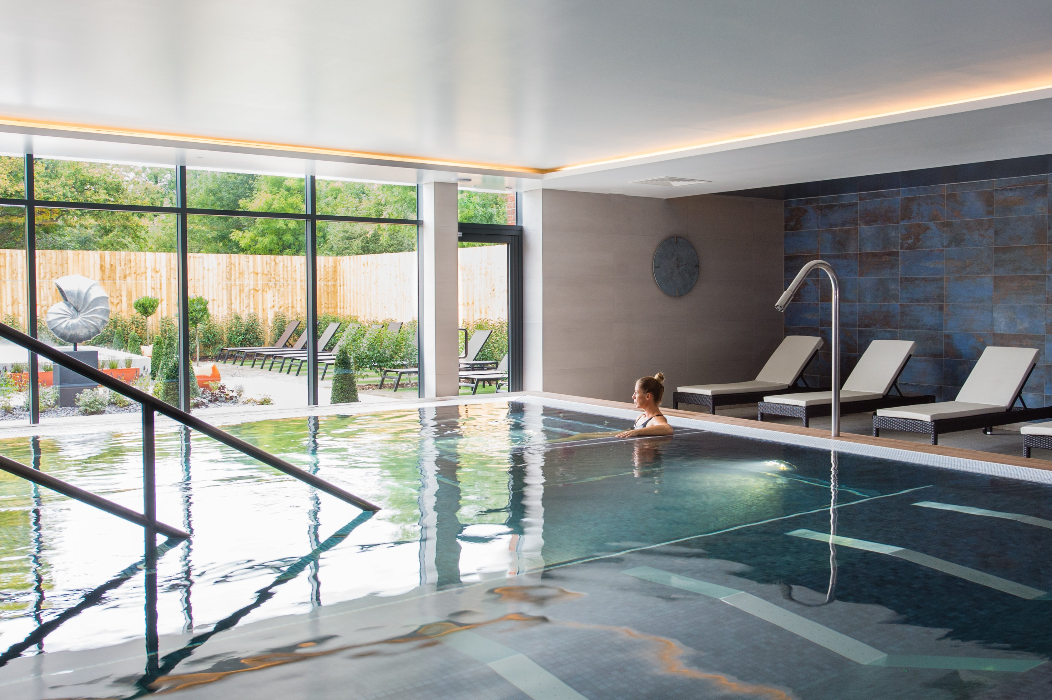 Woman relaxing in the indoor hydro pool in the Spa Retreat at David Lloyd Chigwell