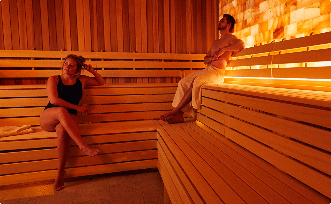 Two friends enjoying their time the steam rooms and sauna