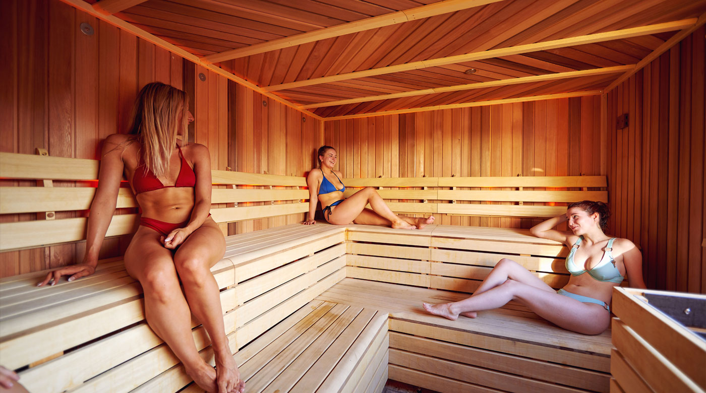 Friends chatting and relaxing in the sauna