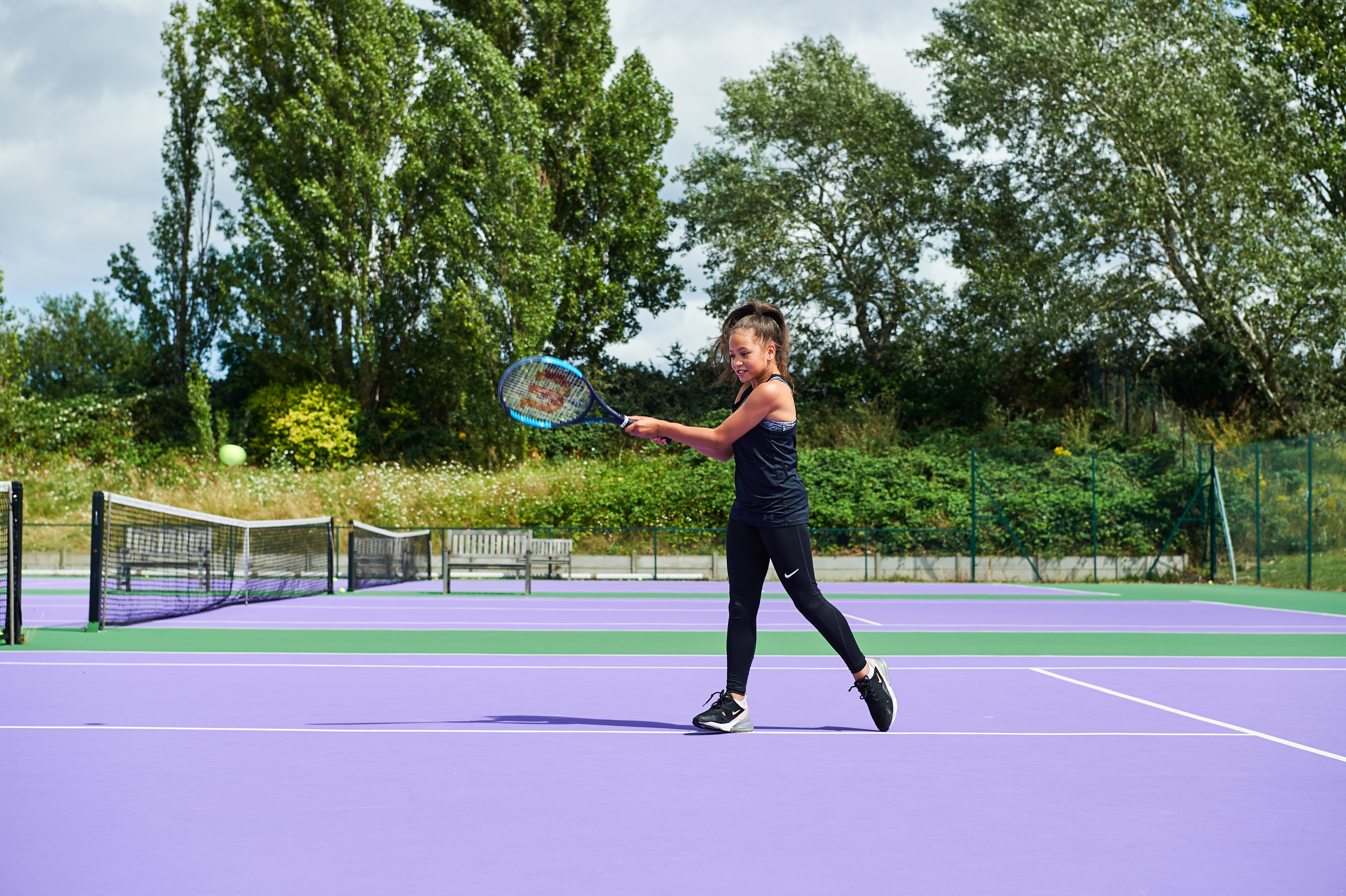 Girl on a tennis court