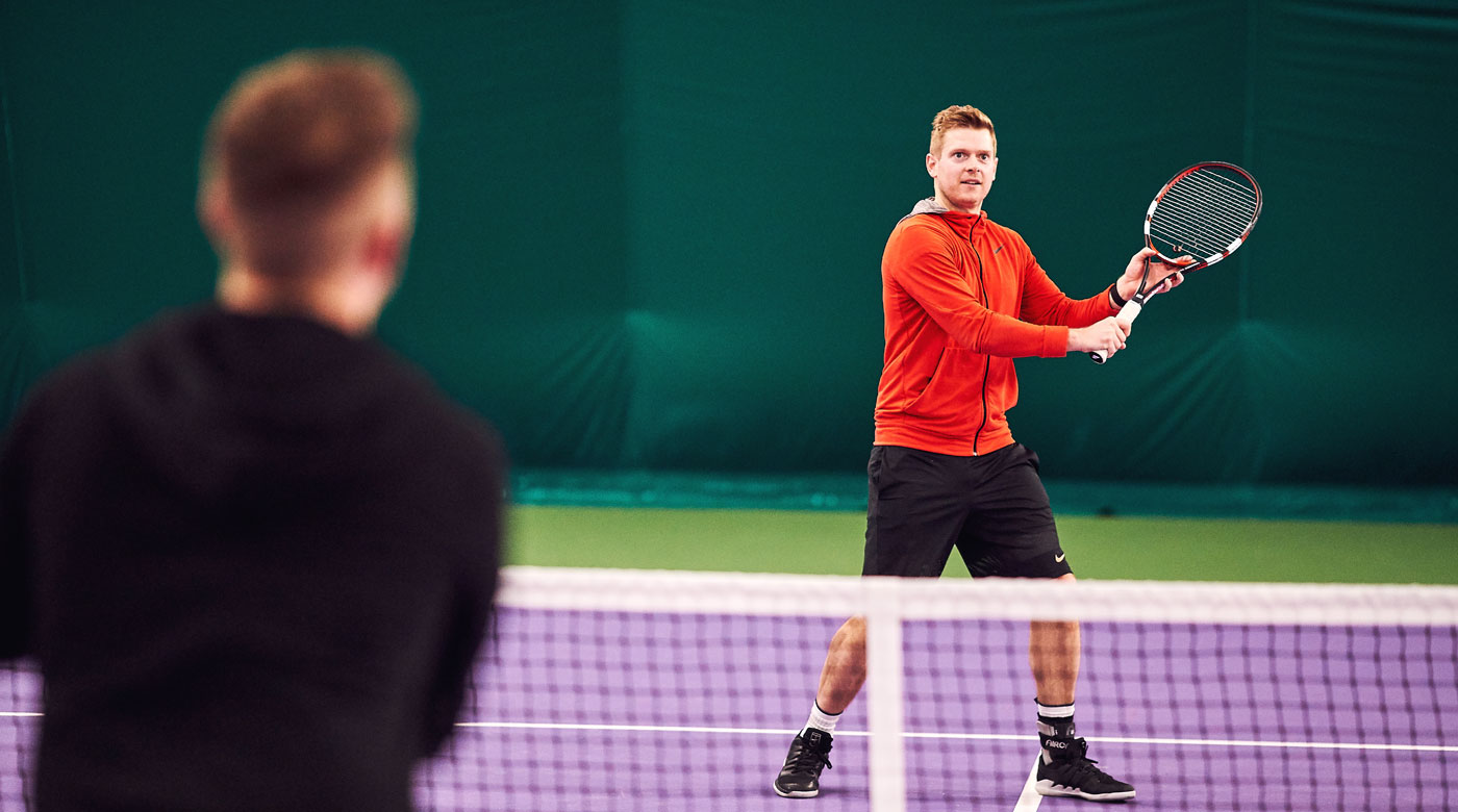 Tennis player hitting a volley at David Lloyd Leeds