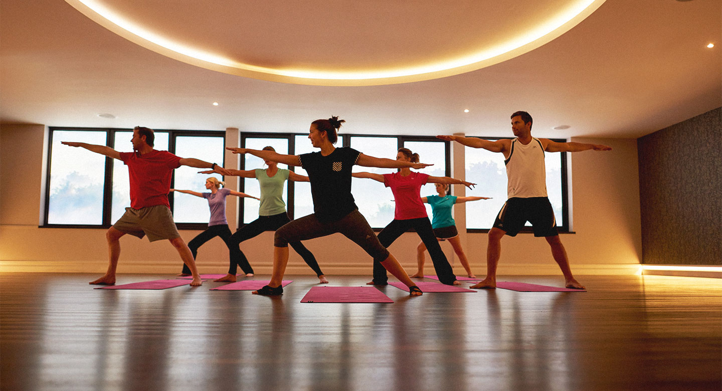 Image of a group of people taking part in a yoga class